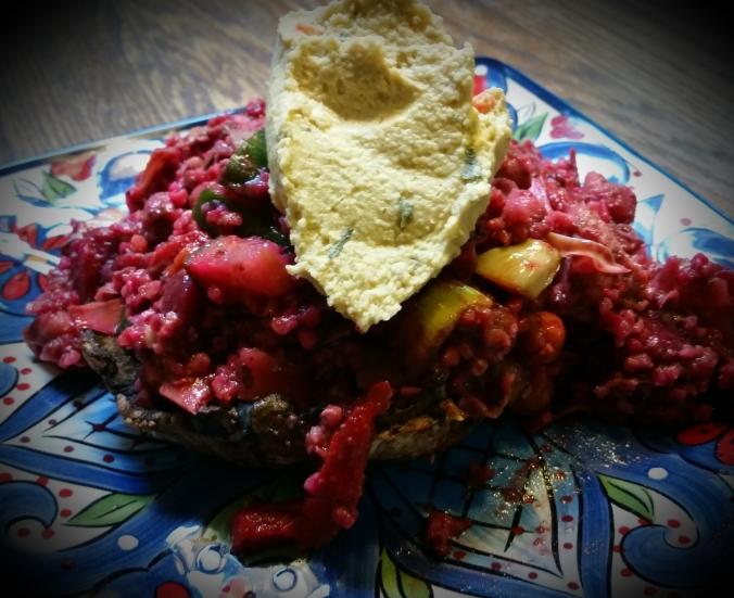 Roasted Portabello Mushroom Stuffed with Veggie-ful Grain Salad Topped with Hummus