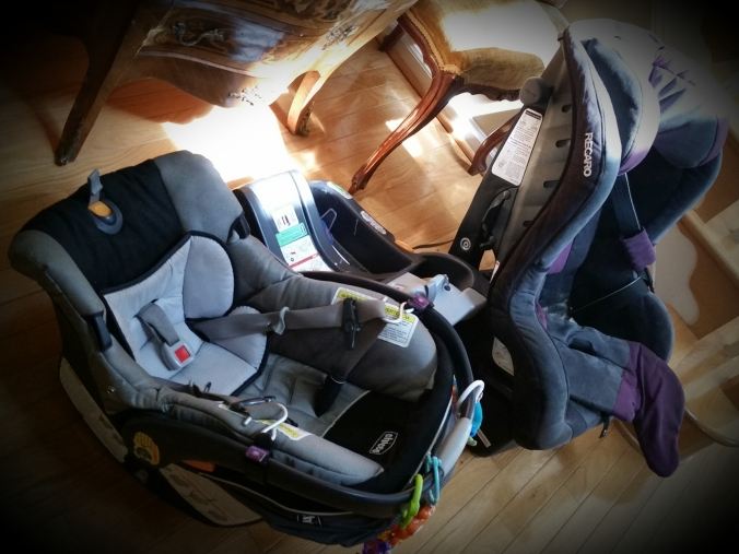 #3's infant car seat and #1's final car seat ready for retirement